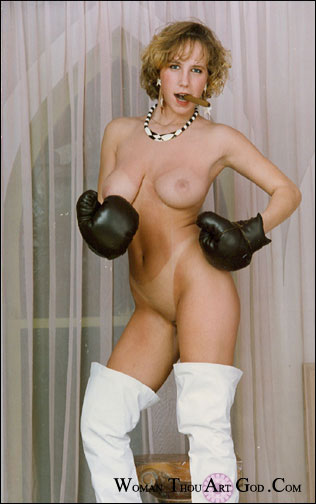 Gorgeous, voluptuous naked girl with sexy bikini tan lines in thigh high white boots beckoning with a cigar in mouth and black boxing gloves